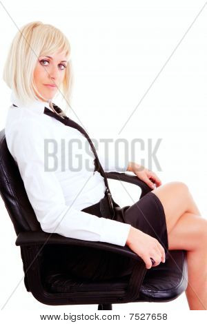 Blond Businesswoman Sitting On Chairisolated Over White