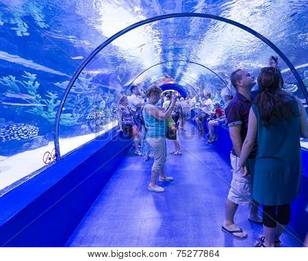 Antalya, Turkey-1 September 2014 People in the  aquarium. IT  is  longest of  world panoramic tunnel