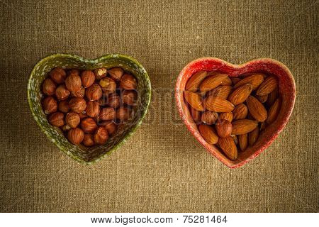 Assorted nuts in dishes
