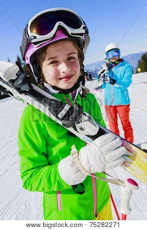 Ski, skier, snow and fun - skiers enjoying winter vacations