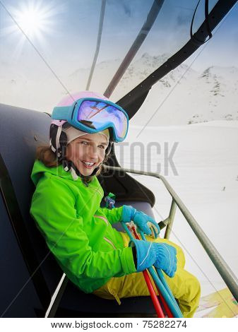 Ski, skiing - lovely skier on ski lift