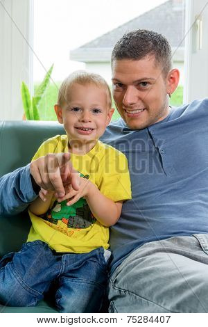 portrait of a cheerful boy with his father