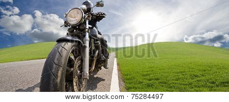 Low Angle View Of Man Riding Bike Against Clear Sky