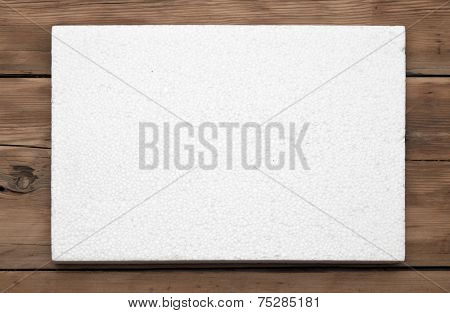 Poly foam texture on wood background