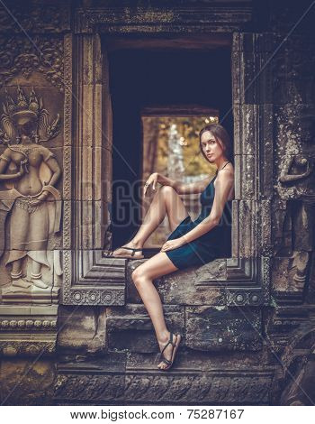 Girl posing in Angkor Wat Temple, Cambodia