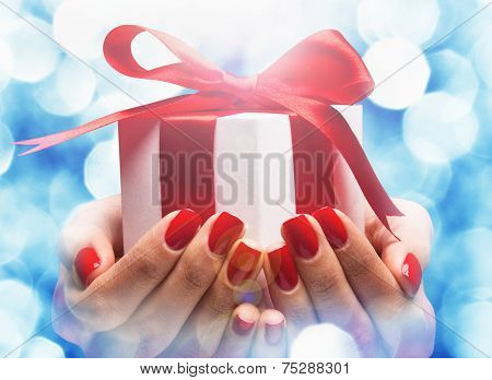 Christmas gift in female hands