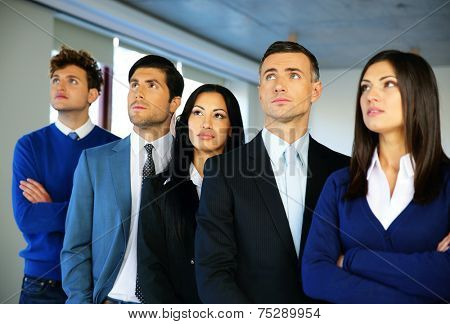 Group of business people in the office. Look to the top.