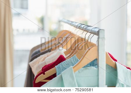 Close up of clothing rail at clothes store