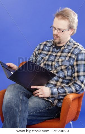 Man Reads Business Papers