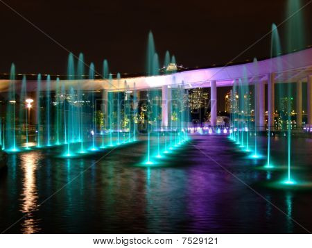colourful lighted water fountain at Marina Barrage