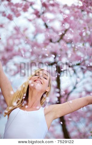 Woman Throwing Cherry Blossoms