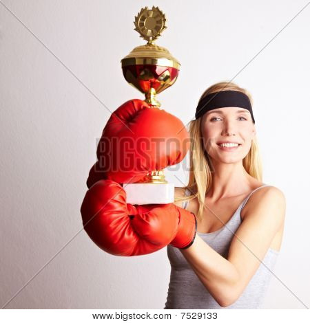 Female Boxer With Trophy