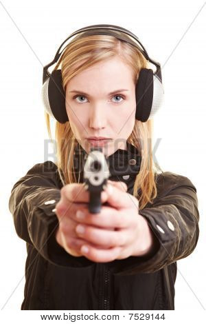 Woman With Gun And Ear Protection