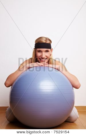 Sportive Woman Behind Gym Ball