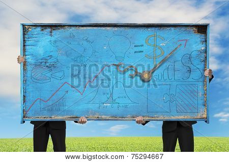 Two Men Holding Old Blue Doodles Billboard On Nature Sky