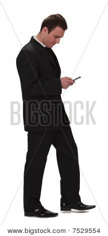 Businessman Checking The Mobile Phone