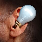 stock photo of ear  - Listen to ideas concept as a lightbulb inside a human ear as a symbol of listening and tuning in to creative thoughts and hearing success advice - JPG