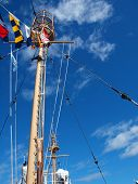 picture of wispy  - Columbia Lightship Main Light with Nautical Flags Hanging with Wispy Clouds - JPG