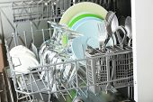 picture of dishwasher  - Open dishwasher with clean utensils in it - JPG