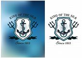 stock photo of trident  - King Of The Sea nautical themed badge or logo showing a ships anchor in a frame with crossed tridents on a white and blurred blue background - JPG