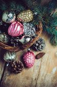 picture of gift basket  - Vintage Christmas decorations in a wicker basket Christmas gift in retro style rustic home decor - JPG