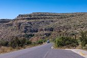 image of guadalupe  - riding through the pinkish ridges of Guadalupe National park on motorhome Texas USA - JPG