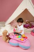 picture of teepee  - Toddler child kid engaged in pretend play with food stuffed toys and teepee tent - JPG