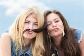 stock photo of mustache  - Friends make funny mustache from each other hair