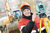 pic of theodolite  - One surveyor worker working with theodolite transit equipment at road construction site outdoors - JPG