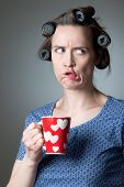 image of disapproval  - A woman in a domestic role showing disapproval with a funny face - JPG