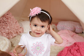 picture of toddlers tiaras  - Toddler child kid engaged in pretend play with a pink flower headband and teepee tent - JPG