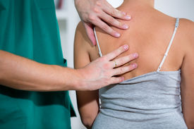 pic of chiropractor  - Chiropractor massage the female patient spine and back - JPG