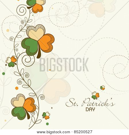 Elegant greeting card design with clover leaves in Irish Flag colors for Happy St. Patrick's Day celebration.