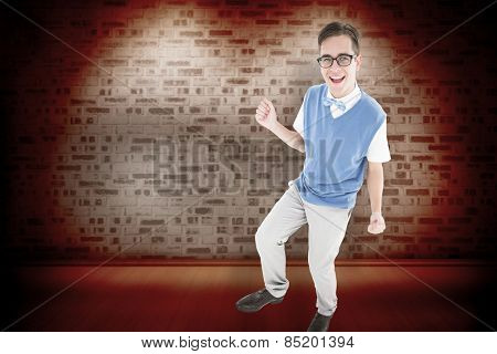 Geeky young hipster smiling at camera against orange