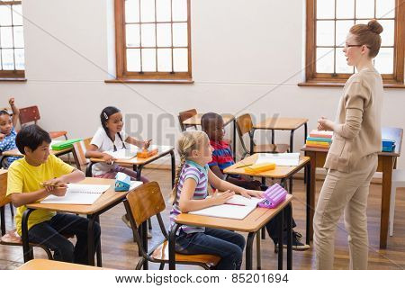 Teacher giving a lesson in classroom at the elementary school