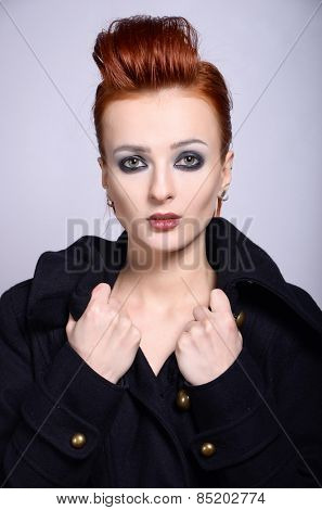 Woman in coat with cold look. Fashion portrait