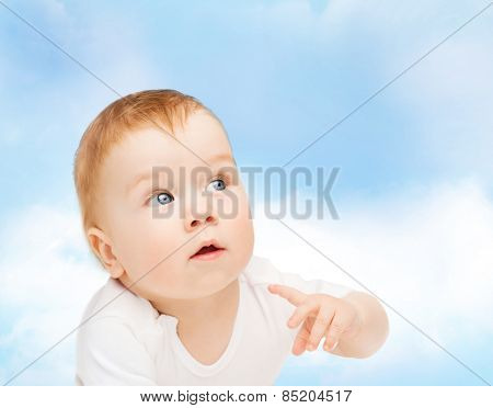 child and toddler concept - curious baby looking side