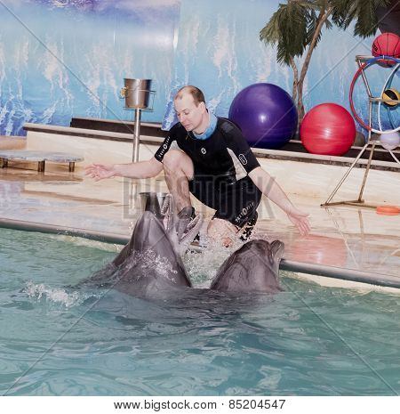 Trainer Conducts Singing Dolphins In The Rostov Dolphinarium