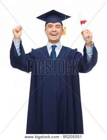 education, graduation and people concept - smiling adult student in mortarboard with diploma rising hands up and laughing