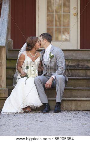 Bride and groom having special moment seated on steps