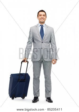 business trip, traveling, luggage and people concept - happy businessman in suit with travel bag