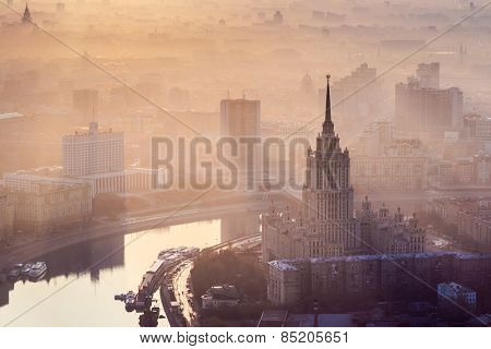 Sunrise in the foggy day over Moscow. Hotel Ukraine, Moskva river, building of Russian Government