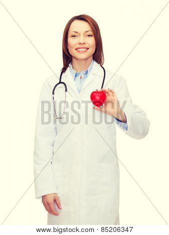 healthcare and medicine concept - smiling female doctor with heart and stethoscope