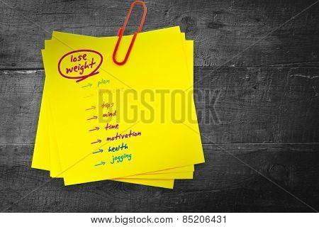 Diet plan against sticky note with red paperclip