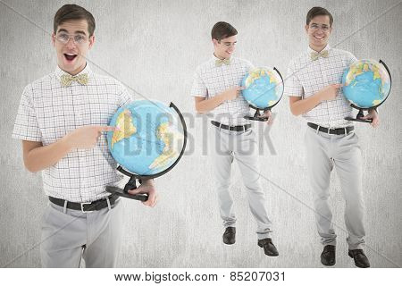 Nerd with globe against white and grey background