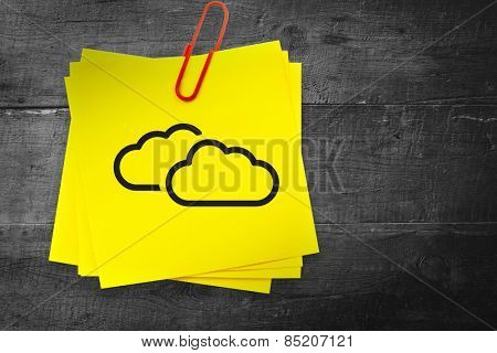 Clouds graphic against sticky note with red paperclip