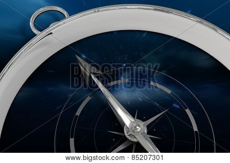 Compass against stars twinkling in night sky