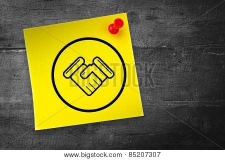 Handshake graphic against yellow pinned adhesive note