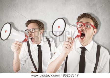 Nerd with megaphone against white and grey background