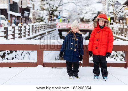Kids at Takayama town in Japan on winter day